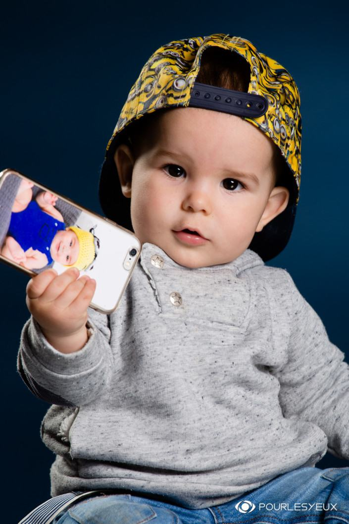 Photographe geneve photo enfant avec casquette